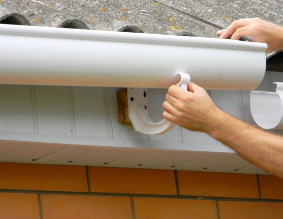 Installation of plastic roof guttering in Sydney's West